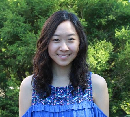 2017 Research Fellow Alyssa Gao in front of a beautiful Wintergreen Korean Boxwood shrub